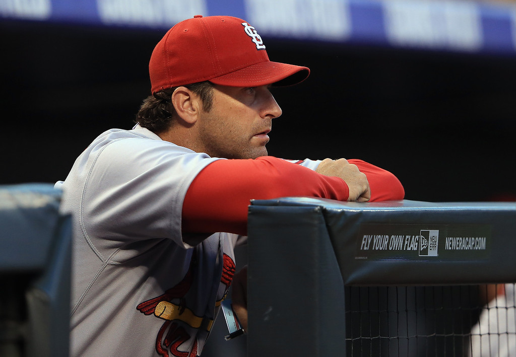 . Manager Mike Matheny #22 of the St. Louis Cardinals looks on from the dugout as he leads his team against the Colorado Rockies at Coors Field on September 17, 2013 in Denver, Colorado.  (Photo by Doug Pensinger/Getty Images)