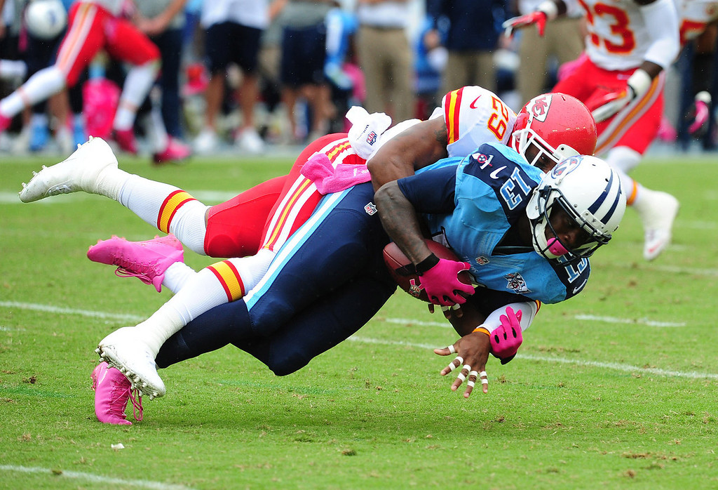 . Kendall Wright #13 of the Tennessee Titans is tackled by Eric Berry #29 of the Kansas City Chiefs at LP Field on October 6, 2013 in Nashville, Tennessee. (Photo by Scott Cunningham/Getty Images)