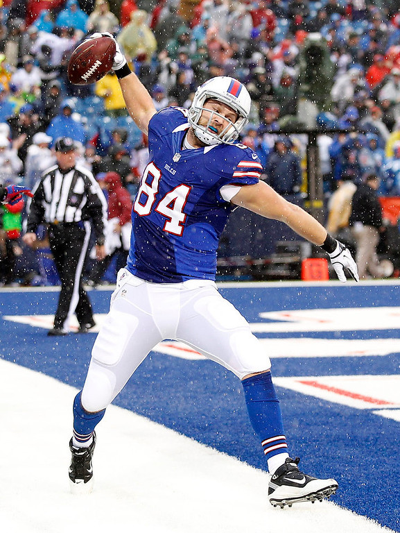 . Buffalo Bills tight end Scott Chandler (84) celebrates a touchdown catch during the first half of an NFL football game against the Jacksonville Jaguars, Sunday, Dec. 2, 2012, in Orchard Park, N.Y. (AP Photo/Bill Wippert)