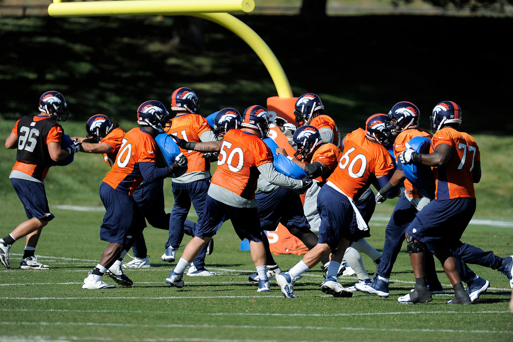 . Denver Broncos offensive line gets in blocking drills during practice October 24, 2013 at Dove Valley. (Photo by John Leyba/The Denver Post)