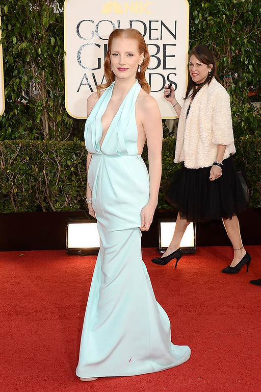". Actress Jessica Chastain, from the film ""Zero Dark Thirty,\"" is on top of Hollywood right now and hard to hate but her look for the Golden Globe Awards doesn\'t compare, gaining her a nomination for our worst dressed list.  (Photo by Jason Merritt/Getty Images)"