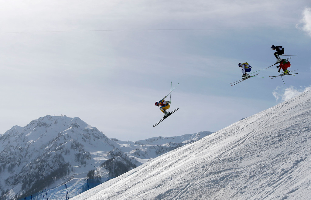 . Sweden\'s Victor Oehling Norberg, left, leads Russia\'s Igor Korotkov, second left,  Finland\'s Jouni Pellinen, top right, and Switzerland\'s Armin Niederer during the first men\'s ski cross quarterfinal at the Rosa Khutor Extreme Park, at the 2014 Winter Olympics, Thursday, Feb. 20, 2014, in Krasnaya Polyana, Russia. (AP Photo/Sergei Grits)