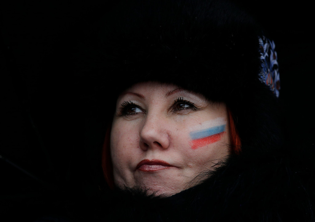 . A Russian fan watches the second run of the women\'s giant slalom at the Sochi 2014 Winter Olympics, Tuesday, Feb. 18, 2014, in Krasnaya Polyana, Russia. (AP Photo/Christophe Ena)