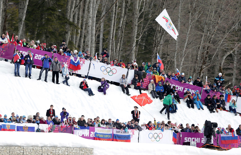 . Spectators line the track of the men\'s cross-country 30k skiathlon at the 2014 Winter Olympics, Sunday, Feb. 9, 2014, in Krasnaya Polyana, Russia. (AP Photo/Matthias Schrader)