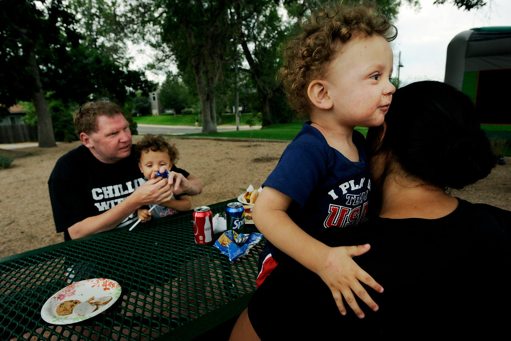 . Brent, left, and wife Ena, right, hold their 2-year-old twins during an eventful day at the Colorado Center for the Blind.  Ena and Brent Batron are both blind, and raising their five kids, all under the age of 10.  Photo by Jamie Cotten, Special to The Denver Post