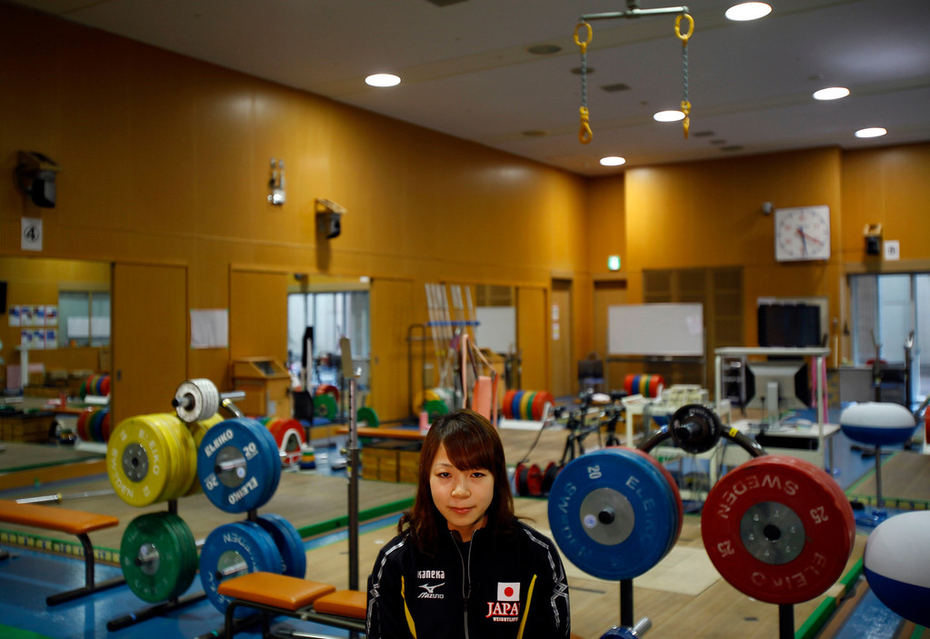 . In this Friday, Aug. 30, 2013 photo, Japanese weightlifter Hiromi Miyake, silver medalist in the London Olympic women\'s 48kg event, sits at a training gym during her interview with the Associated Press in Tokyo. The Olympics are in Miyake\'s blood, a heritage that stretches back to the 1960s, when her uncle won a gold medal at the 1964 Tokyo Games and her father won bronze in Mexico City in 1968. With the Olympics coming to Tokyo in 2020, she hopes that will inspire the next generation of Japanese athletes. (AP Photo/Junji Kurokawa)