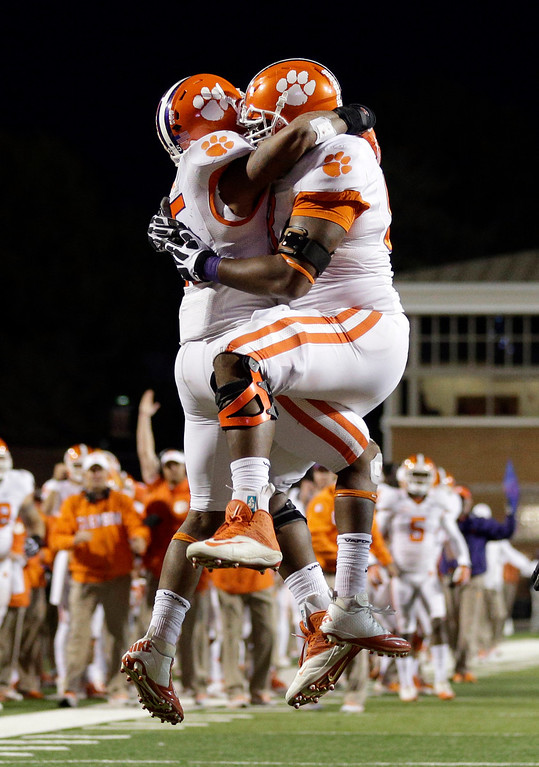 . Clemson running back Roderick McDowell, left, celebrates his touchdown with Brandon Thomas in the second half of an NCAA college football game against Maryland in College Park, Md., Saturday, Oct. 26, 2013. Clemson won 40-27. (AP Photo/Patrick Semansky)
