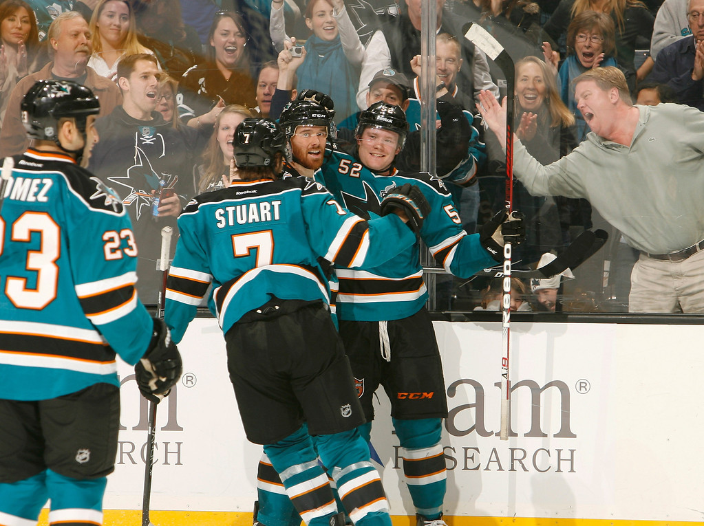 . SAN JOSE, CA - JANUARY 26: Matthew Irwin #52, Martin Havlat #9 and Brad Stuart #7 of the San Jose Sharks celebrate Irwin\'s first career NHL goal against the Colorado Avalanche during an NHL game on January 26, 2013 at HP Pavilion in San Jose, California. (Photo by Don Smith/NHLI via Getty Images)