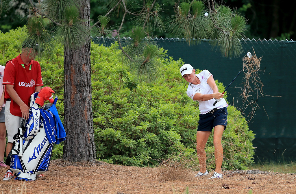 . Stacy Lewis of the USA plays her third shot at the par 4, first hole during the final round of the 69th U.S. Women\'s Open at Pinehurst Resort & Country Club, Course No. 2, on June 22, 2014 in Pinehurst, North Carolina.  (Photo by David Cannon/Getty Images)