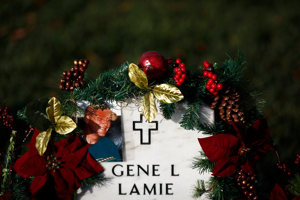 . The gravestone of Army Sgt. Gene Lamie, who died in Iraq on July 6, 2007, in section 60 of Arlington National Cemetery, on Memorial Day in Arlington, Va., May 28, 2012. (Luke Sharrett/The New York Times)