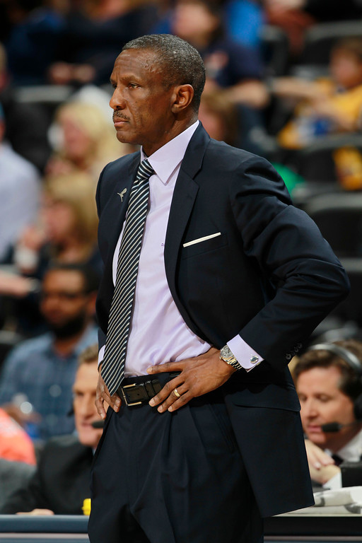 . Toronto Raptors head coach Dwane Casey looks on against the Denver Nuggets in the first quarter of an NBA basketball game in Denver, Friday, Jan. 31, 2014. (AP Photo/David Zalubowski)
