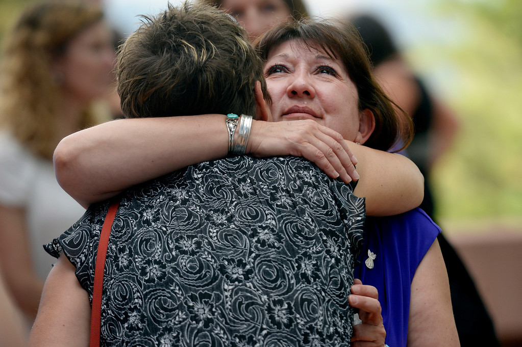 . Glenda Aretxuloeta, right, receives support during a memorial service for her son Wesley Quinlan and Wiyanna Nelson at the National Center for Atmospheric Research in Boulder, CO September 21, 2013.  (Photo By Craig F. Walker / The Denver Post)