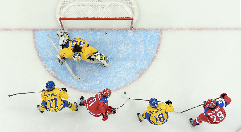 . Russia\'s Yekaterina Smolentseva (2nd L) vies with Sweden\'s Linnea Backman (L), Sweden\'s goalkeeper Valentina Lizana Wallner (top) and Sweden\'s Anna Borgqvist during the Women\'s Ice Hockey Group B match Sweden vs Russia at the Shayba Arena at the Sochi Winter Olympics on February 13, 2014 in Sochi.    ANDREJ ISAKOVIC/AFP/Getty Images