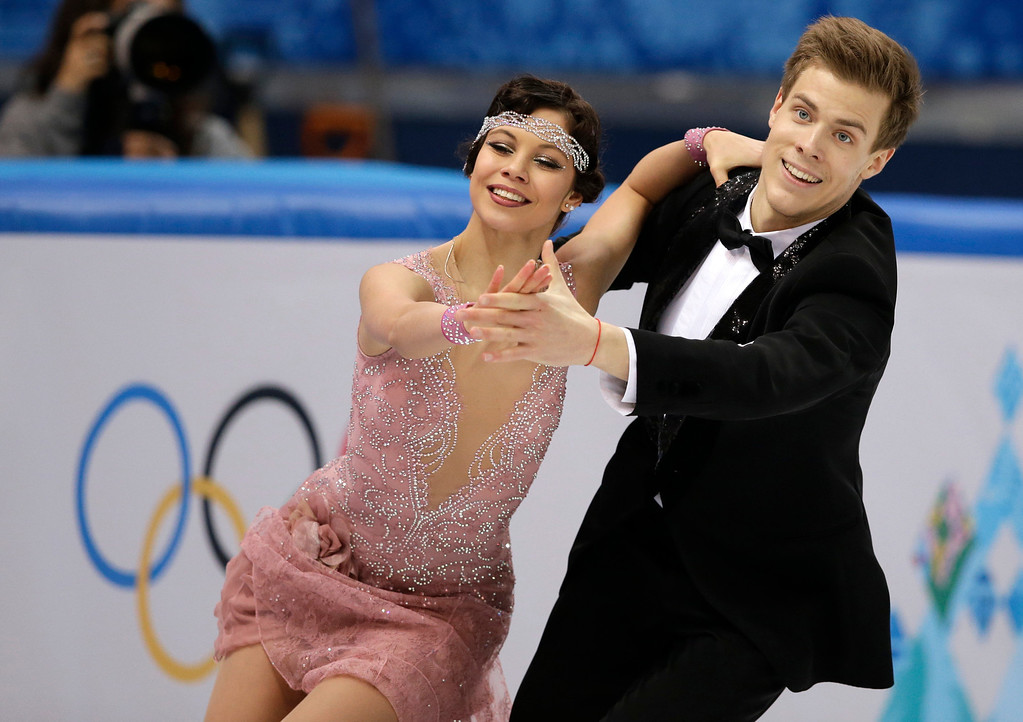 . Elena Ilinykh and Nikita Katsalapov of Russia compete in the ice dance short dance figure skating competition at the Iceberg Skating Palace during the 2014 Winter Olympics, Sunday, Feb. 16, 2014, in Sochi, Russia. (AP Photo/Darron Cummings)