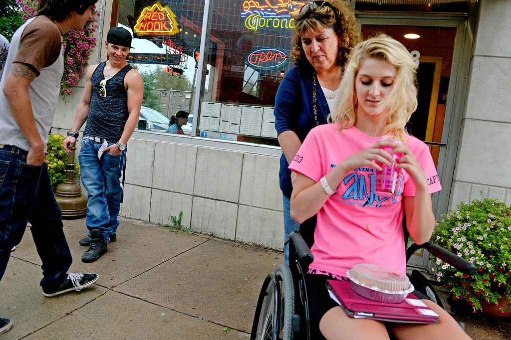 . When some boys teased Mackenzie near Craig Hospital about her �nice chair,� she gave her standard reply: �I�ll trade you.� She asks for their feet, and says they can have the chair. She and her mom, Karen, have grown used to occasional stares and odd comments. (Photo By Craig F. Walker / The Denver Post)