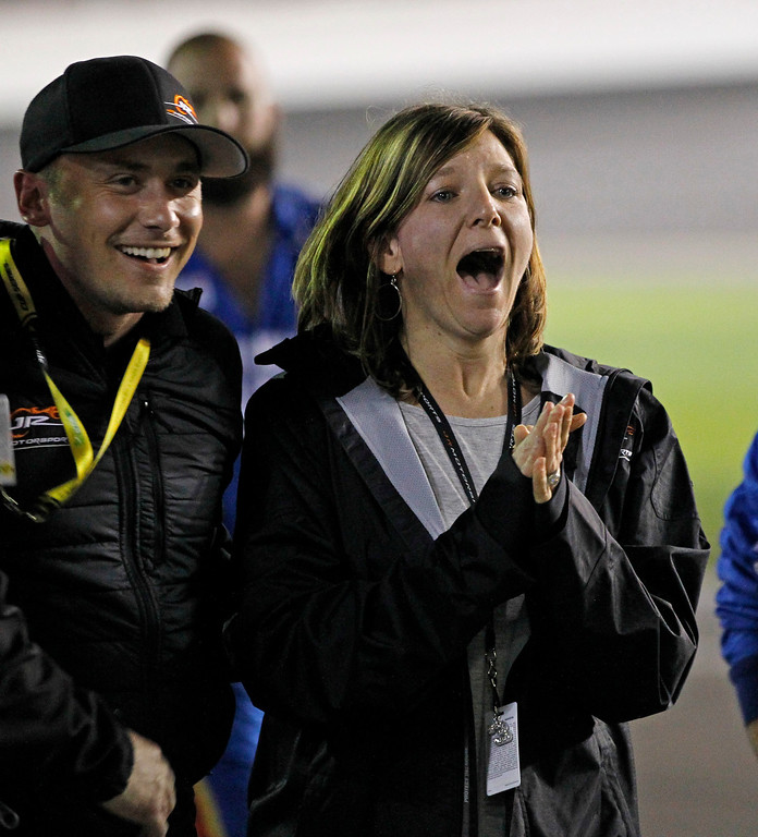 . Kelley Earnhardt Miller, right, celebrates after her brother, Dale Earnhardt Jr, wins the NASCAR Daytona 500 Sprint Cup series auto race at Daytona International Speedway in Daytona Beach, Fla., Sunday, Feb. 23, 2014. (AP Photo/Terry Renna)