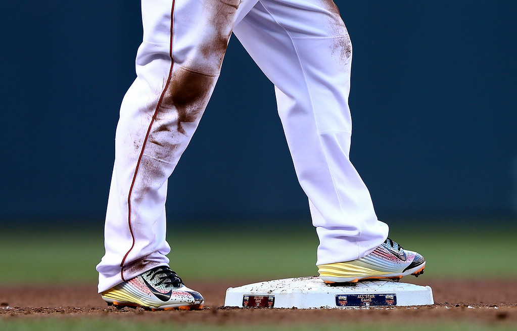 . The cleats of American League All-Star Mike Trout #27 of the Los Angeles Angels are seen during the 85th MLB All-Star Game at Target Field on July 15, 2014 in Minneapolis, Minnesota.  (Photo by Elsa/Getty Images)