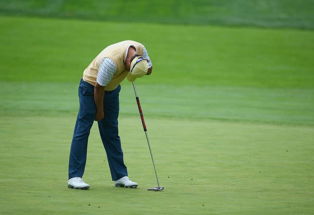 . DUBLIN, OH - OCTOBER 05:  Adam Scott of Australia and the International Team reacts after missing a putt on the 4th hole during the Day Three Four-ball Matches at the Muirfield Village Golf Club on October 5, 2013  in Dublin, Ohio.  (Photo by Andy Lyons/Getty Images)