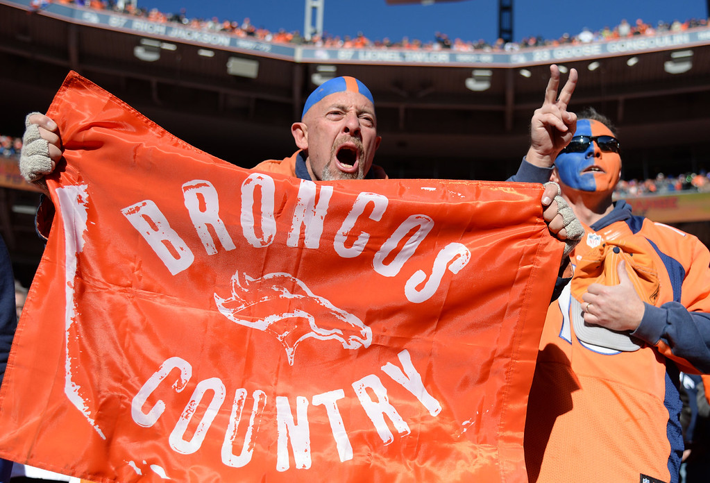 . Denver fans cheer on their team at the start of the game. The Denver Broncos take on the San Diego Chargers at Sports Authority Field at Mile High in Denver on January 12, 2014. (Photo by Hyoung Chang/The Denver Post)