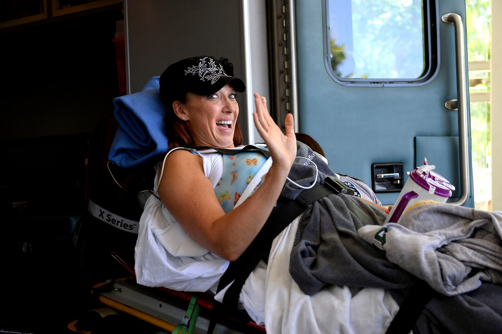 ". Amy Van Dyken-Rouen waves as she arrives at Craig Hospital after leaving Scottsdale Healthcare Osborne Medical Center June 18, 2014 by Angel MedFlight. Amy will join approximately 40 other inpatients with her type of injury from around the U.S. currently undergoing the specialized SCI rehabilitation at Craig. Amy will have a SCI ""Interdisciplinary\"" Team, a physician, rehab nurses and rehab nurse technicians, physical therapist, occupational therapist, clinical psychologist, therapeutic recreation specialist, dietician, clinical care manager, and others. (Photo by John Leyba/The Denver Post)"