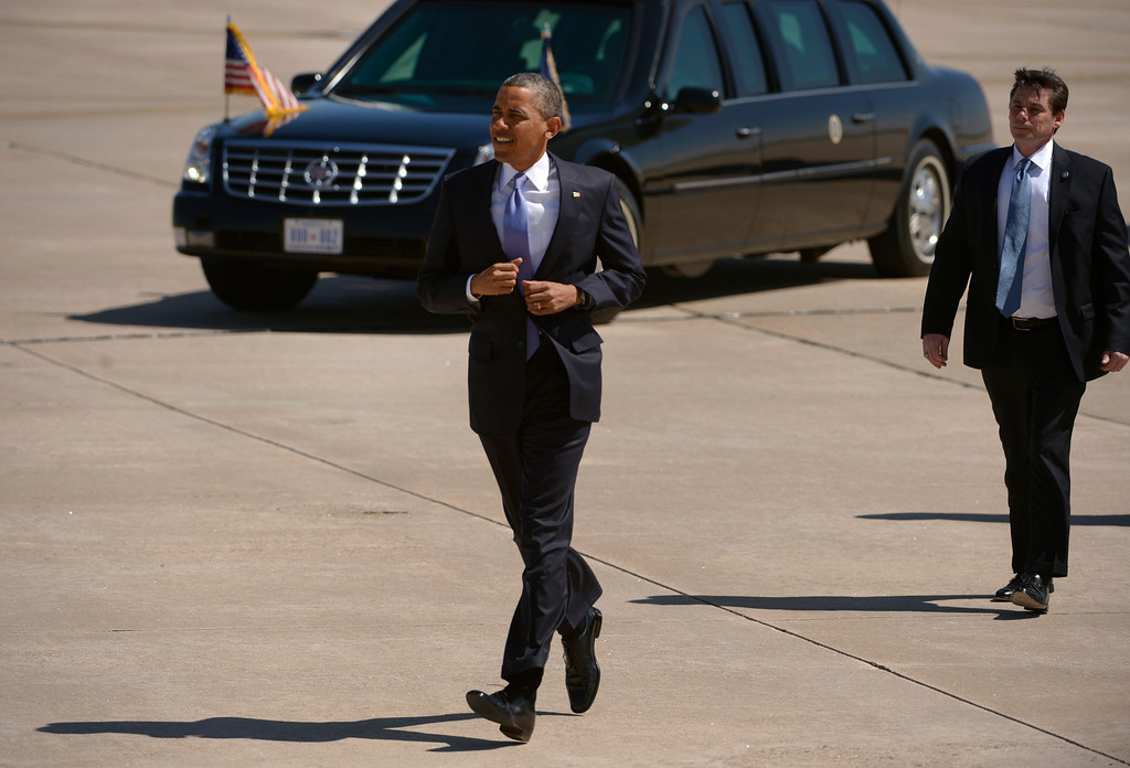 . AURORA, CO- APRIL 3: President Barack Obama jogs to greet  invited guests at Buckley Air Force base take after  arriving  in Aurora, CO aboard Air Force One at Buckley Air Force Base in Aurora, CO on April 3, 2013. The president traveled to Colorado to meet with local law enforcement officials and community leaders to discuss the new gun control measures that the state has put in place including loopholes in the back round check system. (Photo By Helen H. Richardson/ The Denver Post)