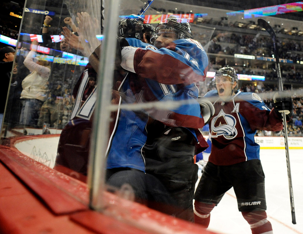 . Colorado Avalanche players celebrate with Kevin Porter after he scored a 2-2 game-tying goal against the Montreal Canadiens during the second period on Sunday, December 19, 2010 at the Pepsi Center. AAron Ontiveroz, The Denver Post