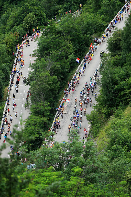 . ALPE D\'HUEZ, FRANCE - JULY 18:  Riders make their way up the final climb during stage eighteen of the 2013 Tour de France, a 172.5KM road stage from Gap to l\'Alpe d\'Huez, on July 18, 2013 in Alpe d\'Huez, France.  (Photo by Doug Pensinger/Getty Images)