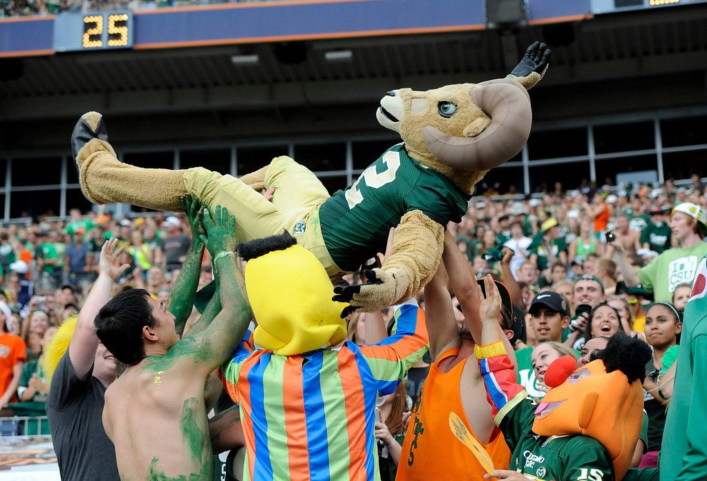 . Colorado State mascot Cam the Ram gets tossed by fans during the Rocky Mountain Showdown at Sports Authority Field at Mile High Stadium Saturday afternoon September 1, 2012. The Rams defeated the Buffs 22-17. The Denver Post/ Andy Cross