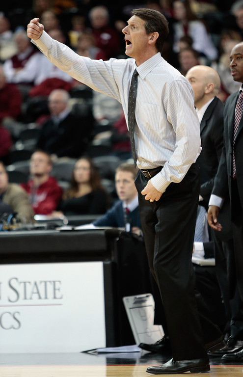 . Head coach Ken Bone of the Washington State Cougars directs his players during the final moments of the second half against the Colorado Buffaloes at Spokane Arena on January 8, 2014 in Spokane, Washington. Colorado defeated Washington State 71-70.  (Photo by William Mancebo/Getty Images)