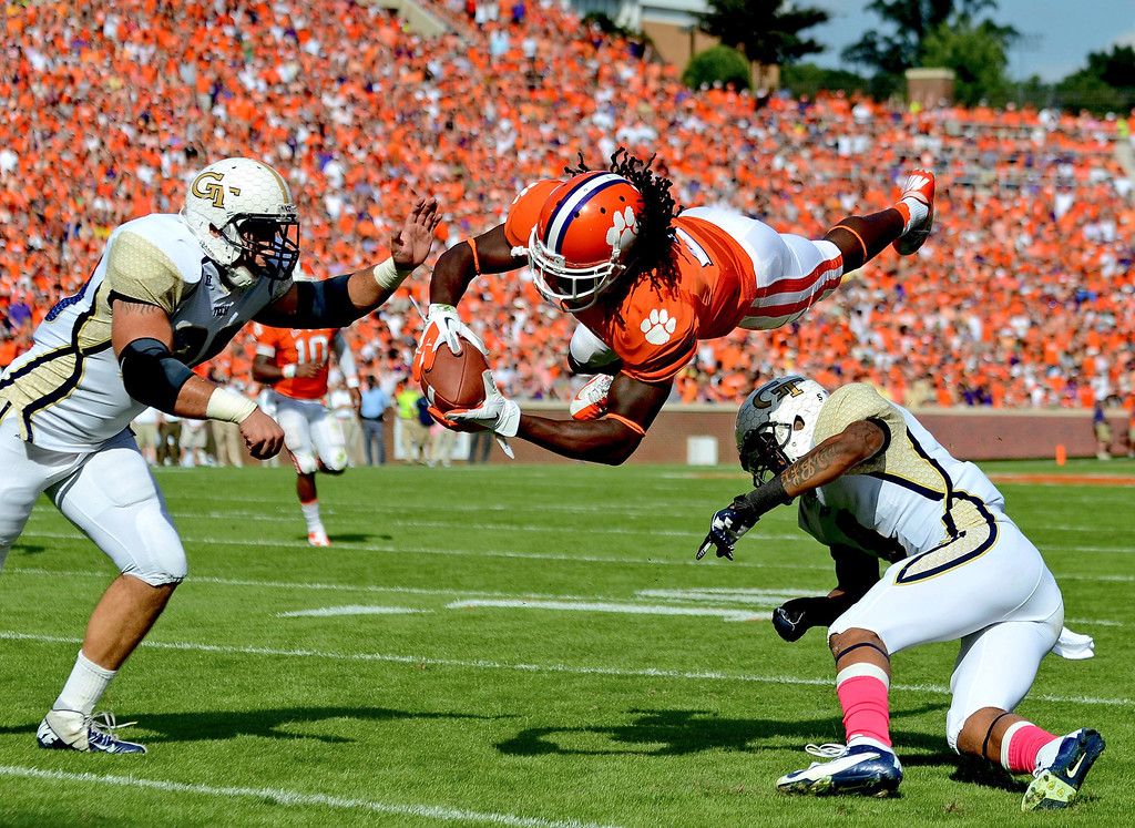 . In this Oct. 6, 2012, file photo, Clemson wide receiver Sammy Watkins dives between Georgia Tech defenders Daniel Drummond, left, and Louis Young to the 1-yard line during the first half of an NCAA college football game at Memorial Stadium in Clemson, S.C. Watkins was picked #4 overall by the Buffalo Bills during the first round of the 2014 NFL Draft. (AP Photo/Richard Shiro, File)