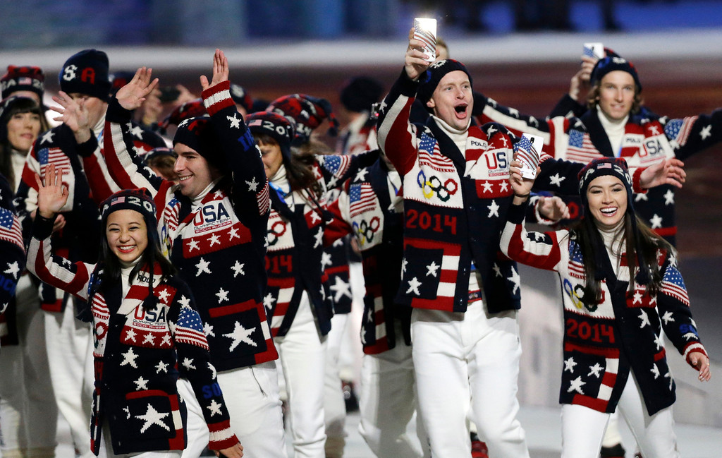 . Athletes from the United States wave to spectators as they arrive during the opening ceremony of the 2014 Winter Olympics in Sochi, Russia, Friday, Feb. 7, 2014. (AP Photo/Mark Humphrey)