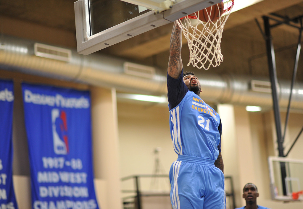 . Wilson Chandler of Denver Nuggets dunks during the practice. The Denver Nuggets take the court for their first official practice under new coach Brian Shaw at Pepsi Center. Denver, Colorado. October 1, 2013. (Photo by Hyoung Chang/The Denver Post)