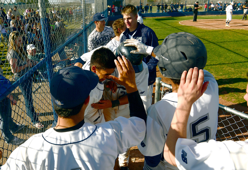 . LITTLETON, CO - APRIL 16,  2014: Columbine Rebels Donny Ortiz, #3, middle, and Michael Tait, second from right, are congratulated by their teammates after both scoring off of Ortiz\' fourth inning home run  during their game against the Ralston Valley Mustangs at Columbine High School in Littleton, Co on April 17, 2014. Columbine pitcher Blake Weiman had a great game and was taken out in the fifth inning when the Rebels were up 8 to 1 over the Mustangs. (Photo By Helen H. Richardson/ The Denver Post)