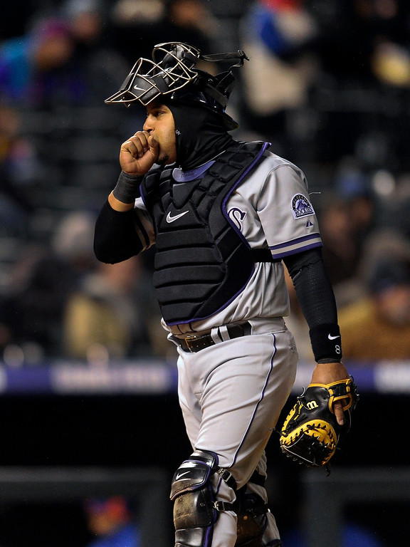 . DENVER, CO. - APRIL 16:  Catcher Yorvit Torrealba tried to warm his hands between pitches in the fifth inning. The Colorado Rockies hosted the New York Mets in the second game of a doubleheader Tuesday night, April 16, 2013. Monday night\'s game was snowed out at Coors Field.  Photo By Karl Gehring/The Denver Post)