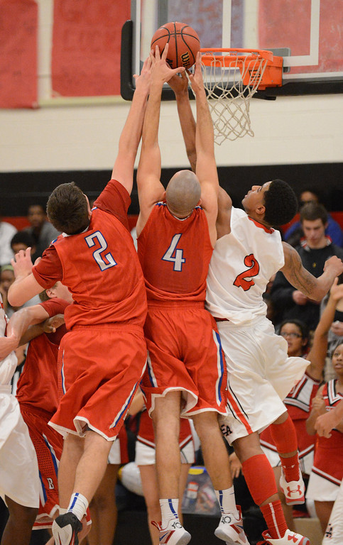 . From left, Cherry Creek\'s Griffin Parr and Sam Stoveall are fight for the ball with East\'s Jevon Griffin in the 1st half of the game at East High School on Friday, Nov. 30, 2012. Hyoung Chang, The Denver Post