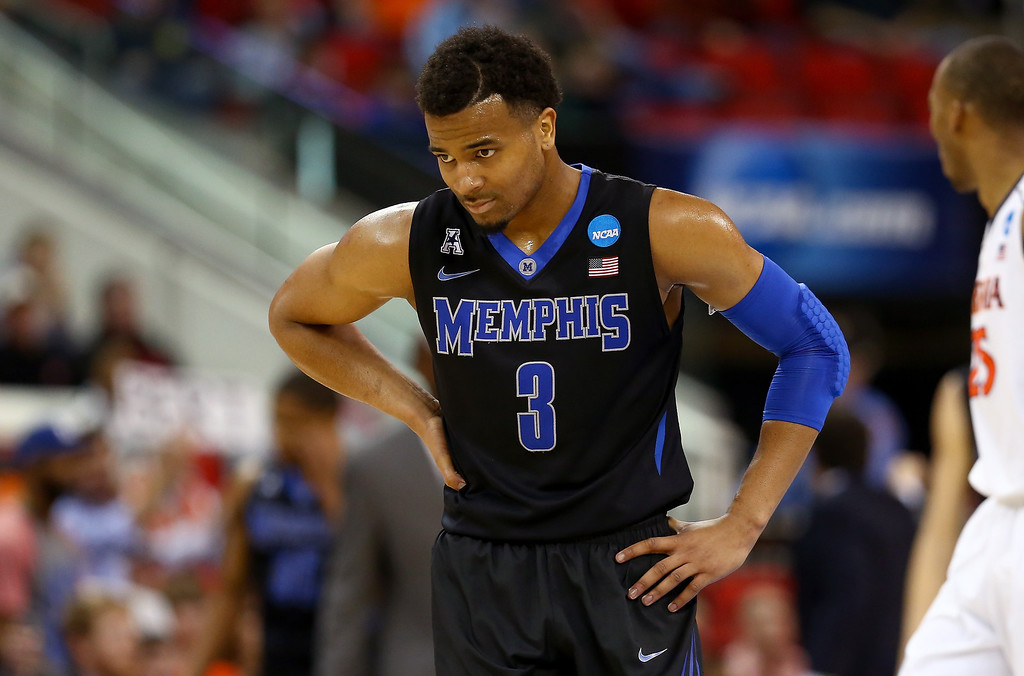 . Chris Crawford #3 of the Memphis Tigers looks on in the second half against the Virginia Cavaliers during the third round of the 2014 NCAA Men\'s Basketball Tournament at PNC Arena on March 23, 2014 in Raleigh, North Carolina.  (Photo by Streeter Lecka/Getty Images)