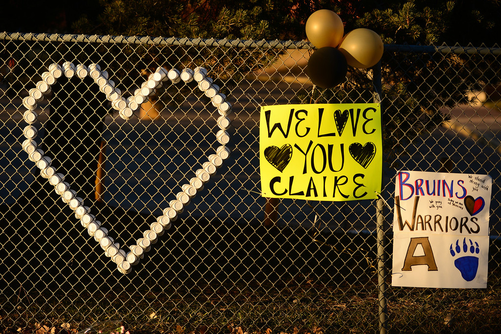 . A tribute for shooting victim Claire Davis is set up along Dry Creek road near Arapahoe High School in Centennial, CO on December 15, 2013. Students from the high school attended a prayer service to pray for the recovery of Davis who was shot during the recent shooting at the high school.  (Photo By Helen H. Richardson/ The Denver Post)