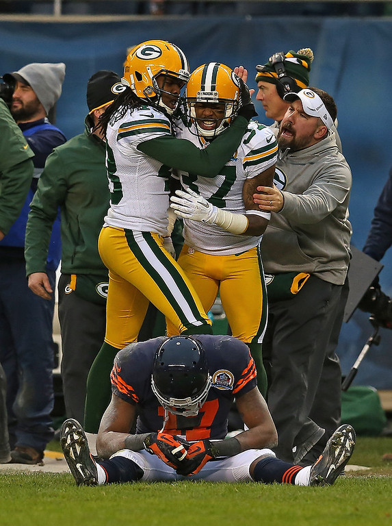 . M.D. Jennings #43 (L) and Sam Shields #37 of the Green Bay Packers celebrate after breaking up a pass intended for Alshon Jeffery #17 of the Chicago Bears at Soldier Field on December 16, 2012 in Chicago, Illinois. The Packers defeated the Bears 21-13. (Photo by Jonathan Daniel/Getty Images)