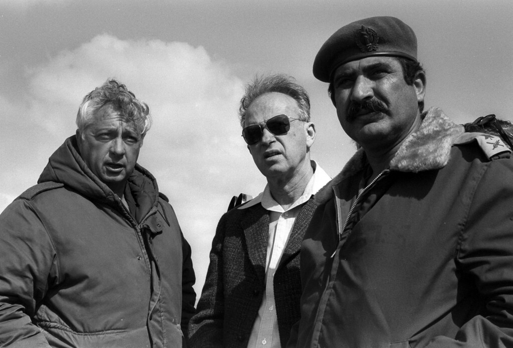 . A photograph supplied by the Israeli Government Press Office (GPO) on 05 January 2014 shows Israeli then Prime Minister Yitzhak Rabin (C) with General Ariel Sharon (L) and General Yekutiel Adam (R) during a visit to the Tassa Camp in the Sinai, Egypt, 19 February 1976. EPA/MOSHE MILNER