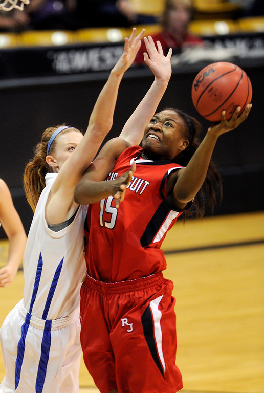 . BOULDER, CO. - MARCH 16: Raiders center Diani Akigbogun (15) worked against Ranch defneder Madison Montgomery (11) in the first half. The Regis Jesuit High School girl\'s basketball team took on Highlands Ranch in the 5A championship game Saturday, March 16, 2013 at the Coors Events Center in Boulder.  (Photo By Karl Gehring/The Denver Post)