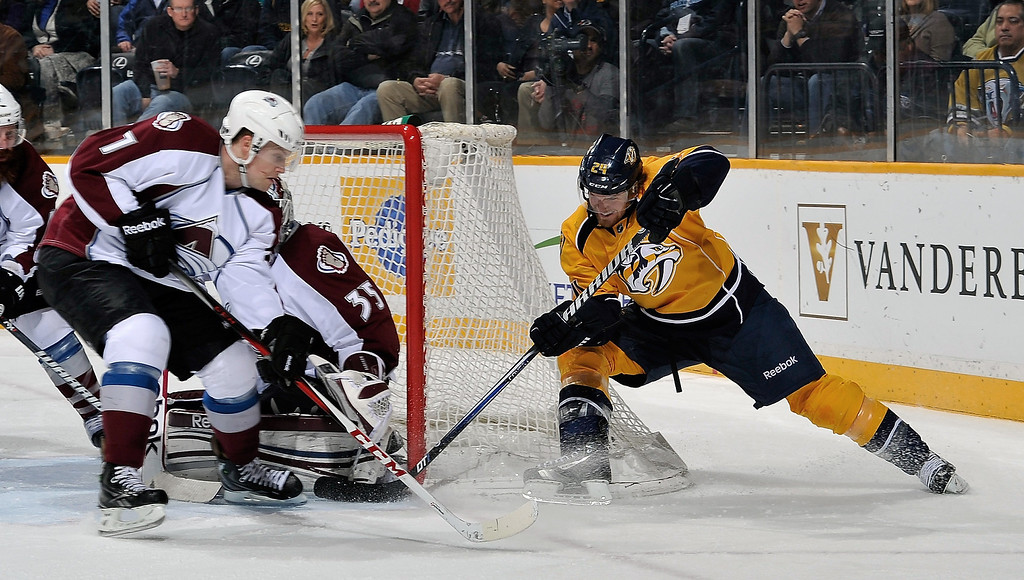 . Matt Halischuk #24 of the Nashville Predators tries to force in a backhand shot against John Mitchell #7 and goalie Jean-Sebastien Giguere #35 of the Colorado Avalanche at the Bridgestone Arena on April 2, 2013 in Nashville, Tennessee.  (Photo by Frederick Breedon/Getty Images)