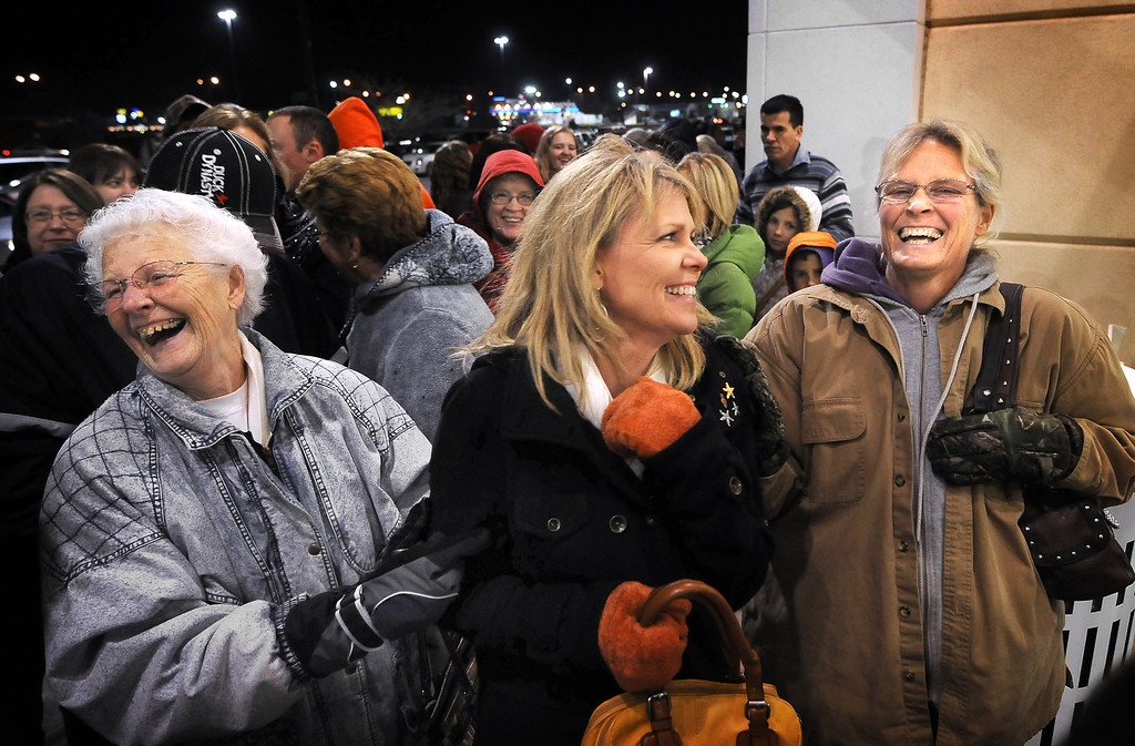 . Ethel Johnson, left, of Salina, Kan., Shelly Quiring, of Chandler, Ariz., and Theresa Nemechek, of Salina, Kan., laugh while waiting in line at Kohls in Salina, Kan., before the doors opened at 8 p.m. Thursday evening, Nov. 28, 2013. They were among the first in line to take advantage of Black Friday sales at the store. (. (AP Photo/The Salina Journal, Tom Dorsey)