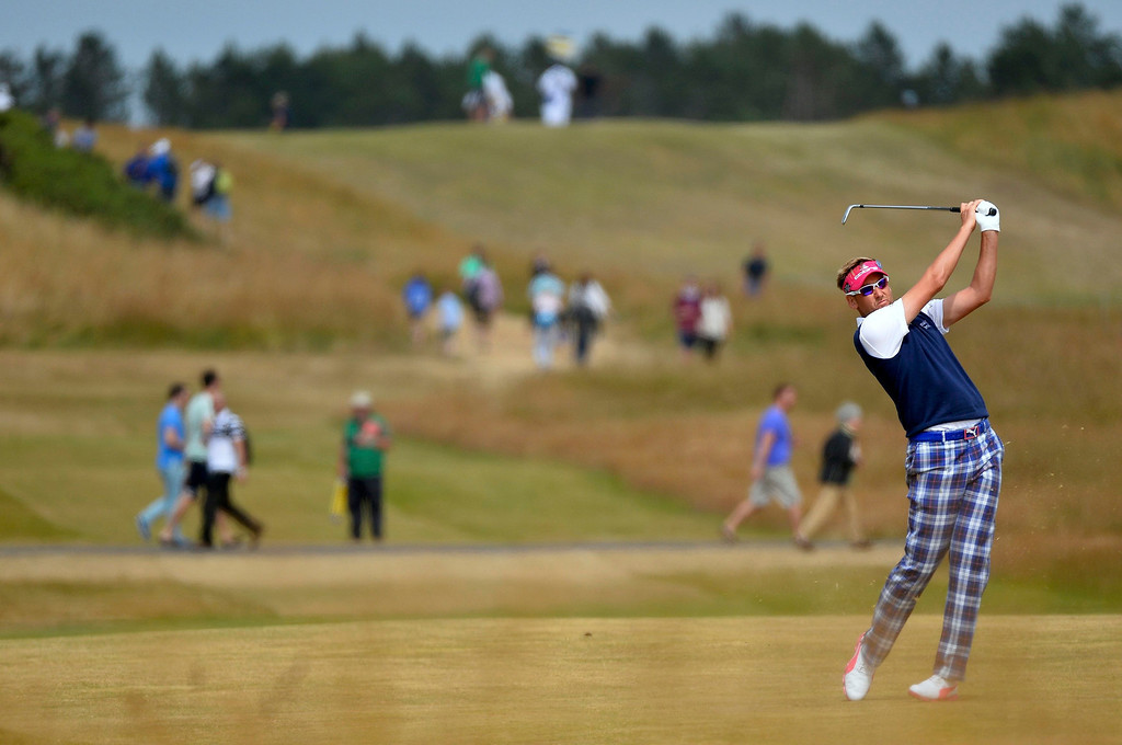 . Ian Poulter of England watches his second shot on the 14th hole during the final round of the British Open golf championship at Muirfield in Scotland July 21, 2013. REUTERS/Toby Melville