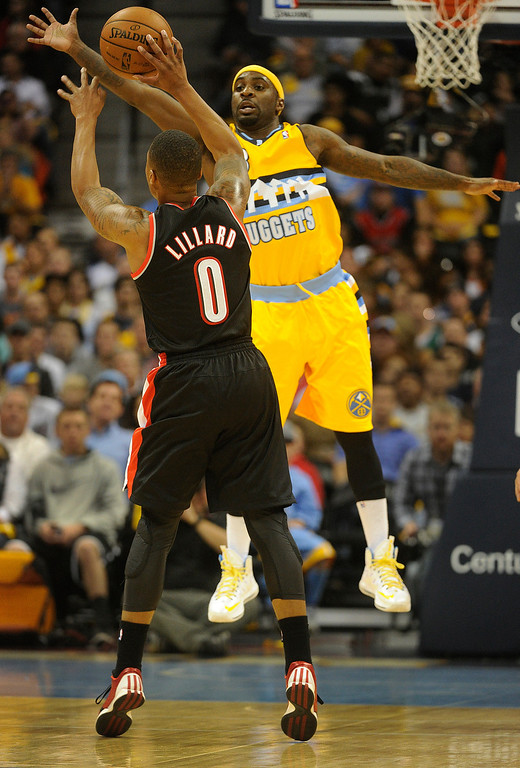 . DENVER, CO. - NOVEMBER 1:  Portland guard Damian Lillard (0) tried to loft a pass over Nuggets defender Ty Lawson (3) in the first half. The Denver Nuggets hosted the Portland Trail Blazers Friday night, November 1, 2013 at the Pepsi Center.  Photo By Karl Gehring/The Denver Post