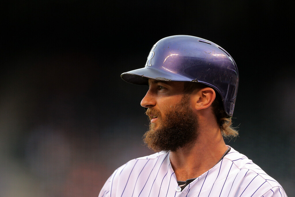 . DENVER, CO - JULY 11:  Charlie Blackmon #19 of the Colorado Rockies looks on before his at-bat during the first inning against the Minnesota Twins at Coors Field on July 11, 2014 in Denver, Colorado.  (Photo by Justin Edmonds/Getty Images)