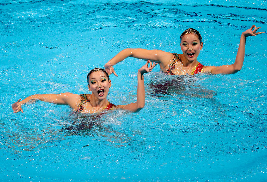 . China\'s Jiang Tingting and Jiang Wenwen perform their routine in the synchronised swimming duet technical final at the FINA Swimming World Championships in Barcelona, Spain,  Sunday, July 21, 2013.  (AP Photo/Mark Baker)