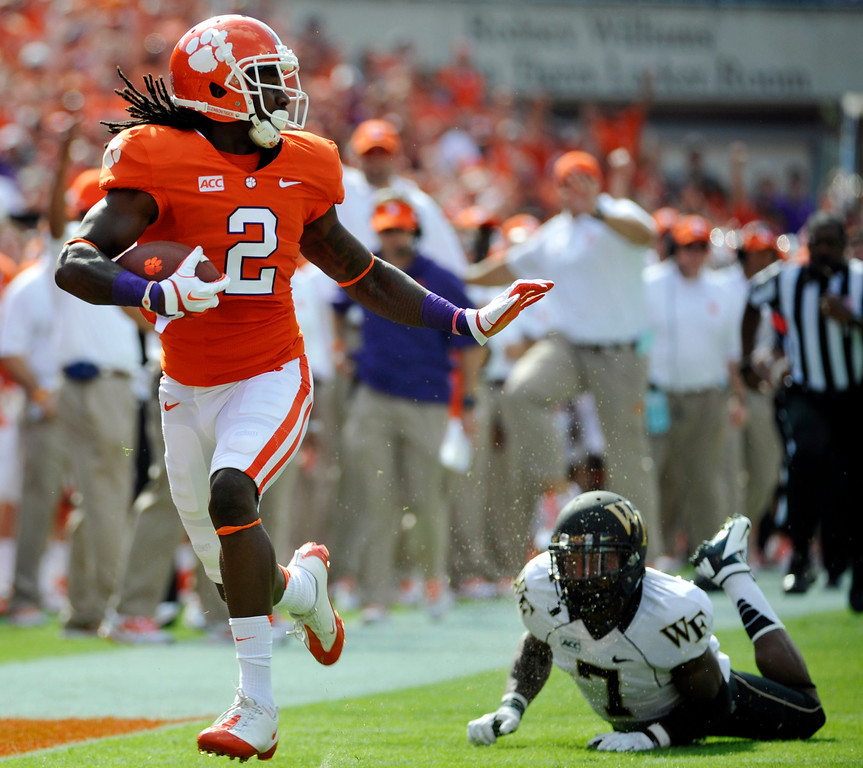 . Clemson wide receiver Sammy Watkins (2) runs for a touchdown after making a catch as Wake Forest  cornerback Merrill Noel (7) defends during the first half of an NCAA college football game, Saturday, Sept. 28, 2013, in Clemson, S.C. (AP Photo/Rainier Ehrhardt)