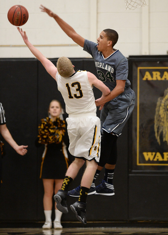 . CENTENNIAL, CO. JANUARY 18: Ryan Swan of  Overland High School (34) blocks the shot of Brendan Till of Arapahoe High School (13) in the 2nd half of the game at Arapahoe High School. Centennial Colorado. January 18. 2014. Arapahoe won 62-54.  (Photo by Hyoung Chang/The Denver Post)