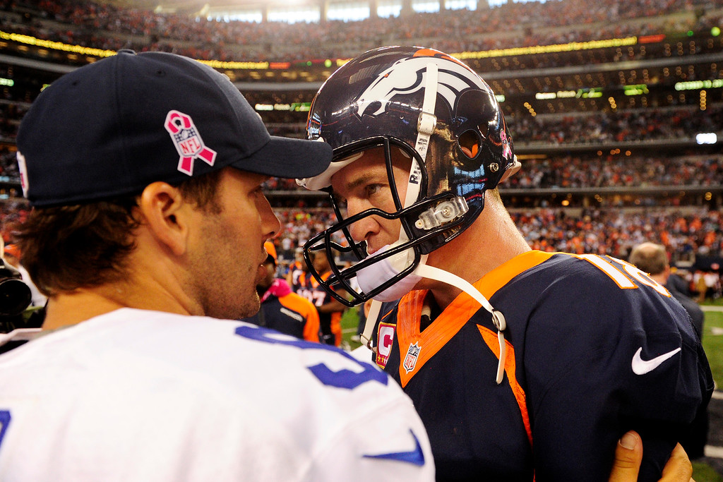 . Peyton Manning (18) of the Denver Broncos and Tony Romo (9) of the Dallas Cowboys talk after the Broncos\' 51-48 win at AT&T Stadium.   (Photo by AAron Ontiveroz/The Denver Post)