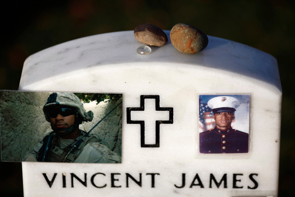 . The gravestone of Marine Staff Sgt. Vincent James Bell, who died Nov. 30, 2011, in Afghanistan, in section 60 of Arlington National Cemetery on Memorial Day in Arlington, Va., May 28, 2012. (Luke Sharrett/The New York Times)